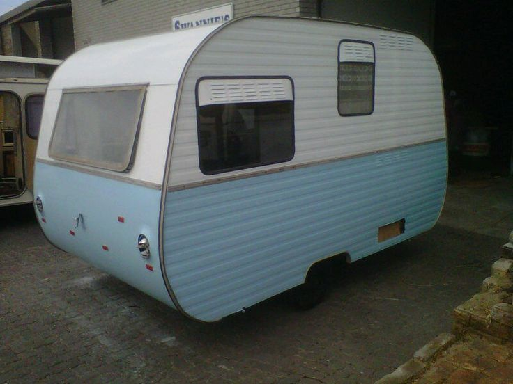 All the preparation is complete & the little caravan is ready to be spray painted. The colours are exactly what I had in mind. She is already starting to look better.