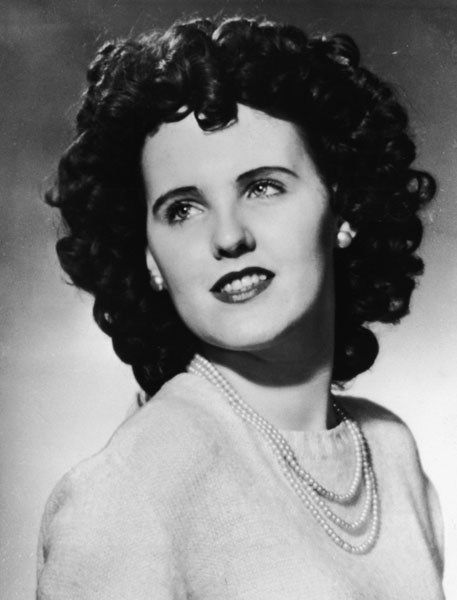 The Black Dahlia: Elizabeth Short: Beautiful 22-year-old Elizabeth Short -- who was found with her body sliced in half at the waist and drained of blood on January 15, 1947 -- has come to be known as The Black Dahlia. The unsolved Los Angeles murder case involving Short, who sported a mane of curly black hair, has intrigued America for decades and spawned books, articles, and movies. Despite years of investigations by police and crime buffs, however, Short's murderer has never been found.