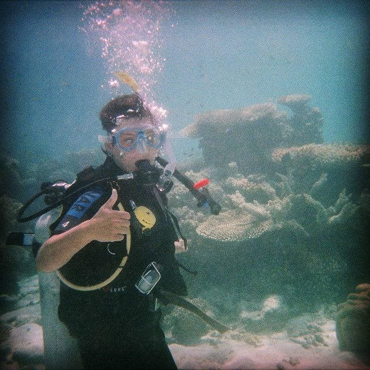 This photo was taken on a cheap underwater camera that took 35mm film. Remember that shit?  So it's unapologetically crap quality but this was me on my very first #scuba dive when I had no regard for correct hand signals and was just freakishly excited to be breathing #underwater next to the Great Barrier Reef. Not so excited that I did a little wetsuit wee y'understand. Just excited enough. .  2007  #diving #dive #scubadiving #padi #trydive #greatbarrierreef #unesco #queensland #fnq…