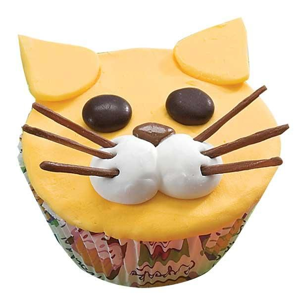 Frisky Feline Cupcakes - Put these cats out at the party and watch the fur fly! With candy features, the decorating is quick and easy—perfect for kids to make and eat!