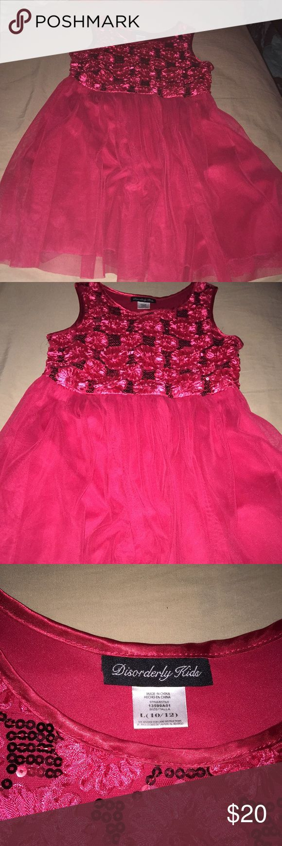 Beautiful Little Girls Dress Size 10-12 This is a beautiful little girl's dress. It's a gorgeous red, sleeveless, with beautiful sequin detailing. It has a flowy, princess bottom. In great condition and from a smoke free pet free home. Disorderly Kids Dresses Formal