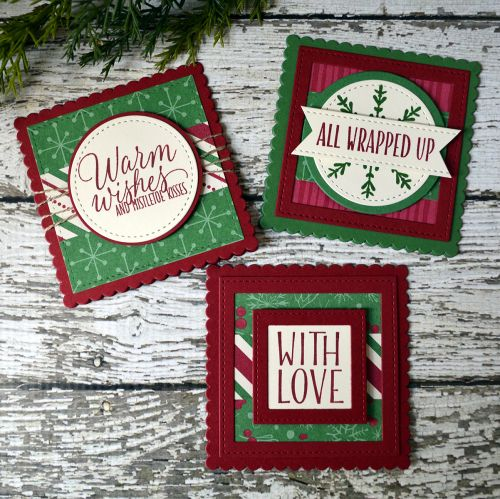by Connie: Tin of Tags set, This Christmas dsp, Stitched Shapes framelits - all from Stampin' Up! Love the banner!