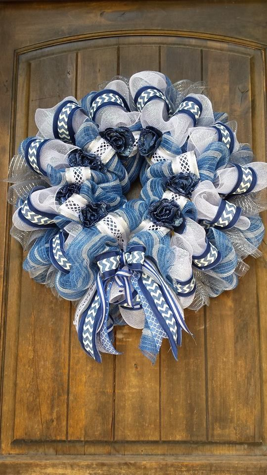 A fun classy denim inspired deco mesh wreath. Complete with blue and white deco mesh colors, denim roses, and fun denim and white ribbon. this wreath could be used all year long. Megan Crandall, Wishing Well Wreaths