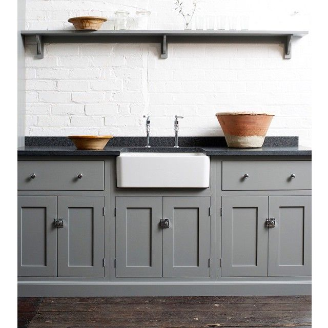 The Loft Shaker kitchen looks beautiful with a mix of black granite worktops, chrome catches and our favourite 'Lead' paint colour. #deVOLKitchens