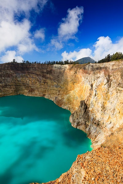 Kelimutu, Flores, Indonesia ~ A view of the striking summit crater lake of Kelimutu, a volcano close to the small town of Moni located roughly 50km to the east of Ende, The lake shown in called Tiwu Ata Polo which translates as the Bewitched or Enchanted Lake.