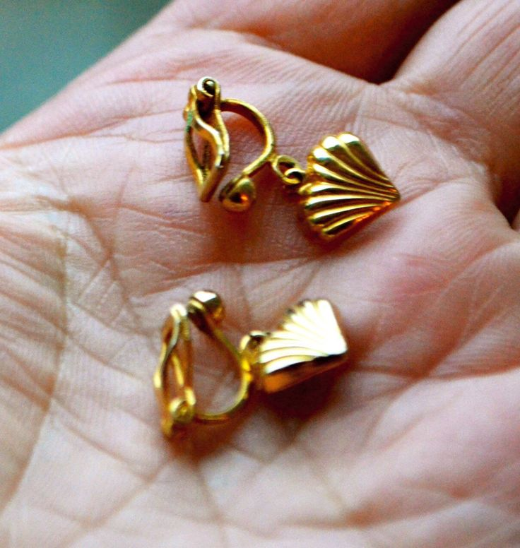 A personal favorite from my Etsy shop https://www.etsy.com/ca/listing/244159033/golden-seashell-earrings-vintage-clip-on