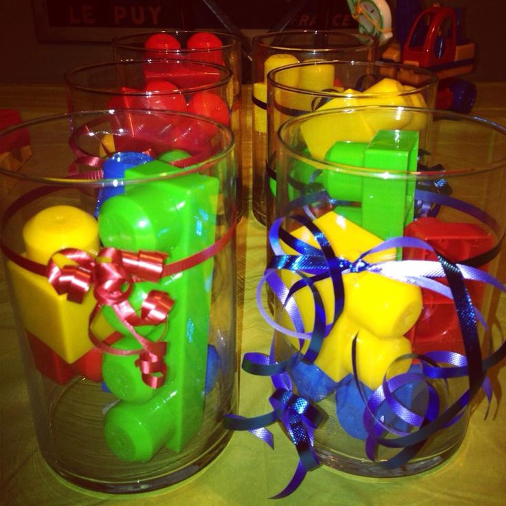 Lego party - center pieces, added lego coloured balloons to each piece!