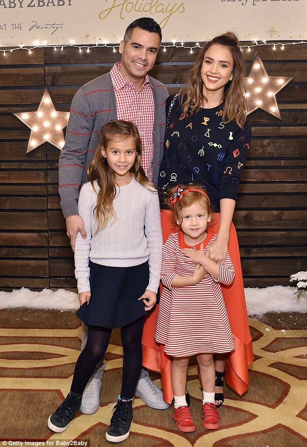Jessica Alba with her husband Cash Warren and their two daughters Honor (left) and Haven (right) at the Baby2Baby Holiday Party in Los Angeles.  (December 2015)