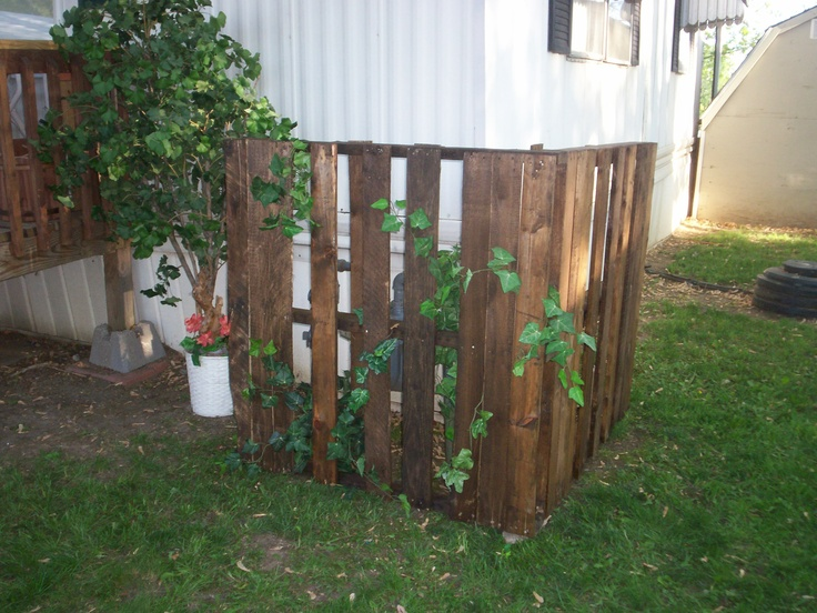 Easy afternoon craft. Took two old pallets, stained with old stain, screwed together at corner and used left over plastic greenery, to add some color. Covered up my tacky gas meter.