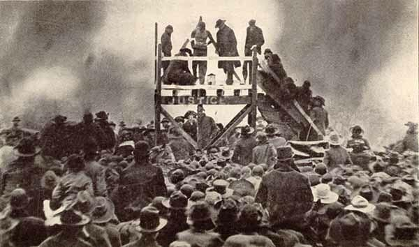 Photo of public lynching of Henry Smith in Paris, Texas in 1893.   Paris, Texas has a horrible race relations history.  Do an Internet search on the place and you be the judge.