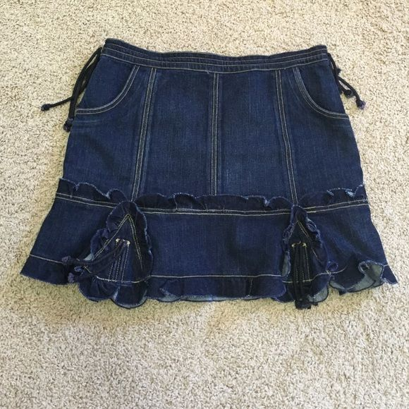 Anna Sui denim skirt Anna Sui denim skirt. Side ties for adjustable waist. Ruffle and tie detail. NWOT. New without tags. 98% cotton 2% spandex. Anna Sui Skirts