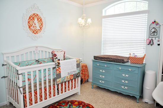 Teal and Orange Vintage Nursery - love the balance between bright and light colors.