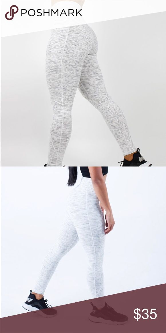 Ethos - High Waisted Legging W/ pockets NOT FABLETICS, only using for exposure. Brand is Ethos! (Google ethos legging) Used in great condition speckled grey gym legging! Comfortable not to thin not too thick fabric, 2 side pockets (both big enough for a large smartphone) High 3.5inch thick waistband for expert comfort, and Printed Logo! Fabletics Pants Leggings