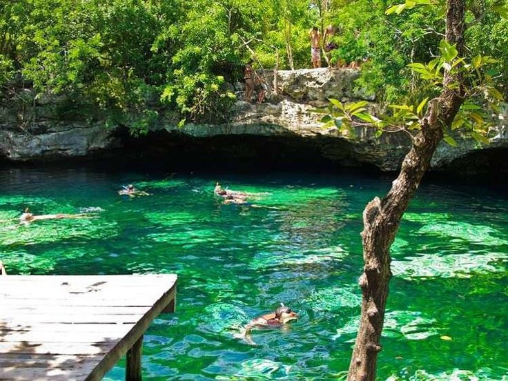 Snorkellers exploring the crystal clear waters of a cenote. Image by Graeme Churchard / CC BY 2.0.