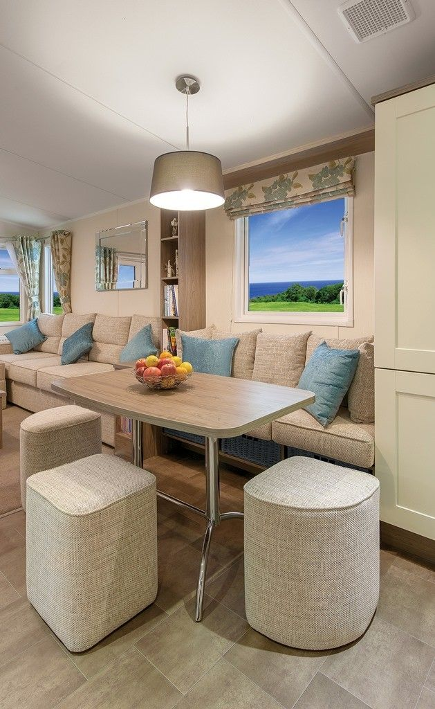 2013 WILLERBY CAMEO (NS14) DINING AREA      Feature banquette seating with additional dining stools     Freestanding dining table     Pendant lighting with large fabric shade     Practical under-seating storage baskets