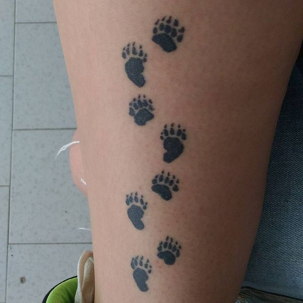 cute and funny bear paw tattoo traces on leg