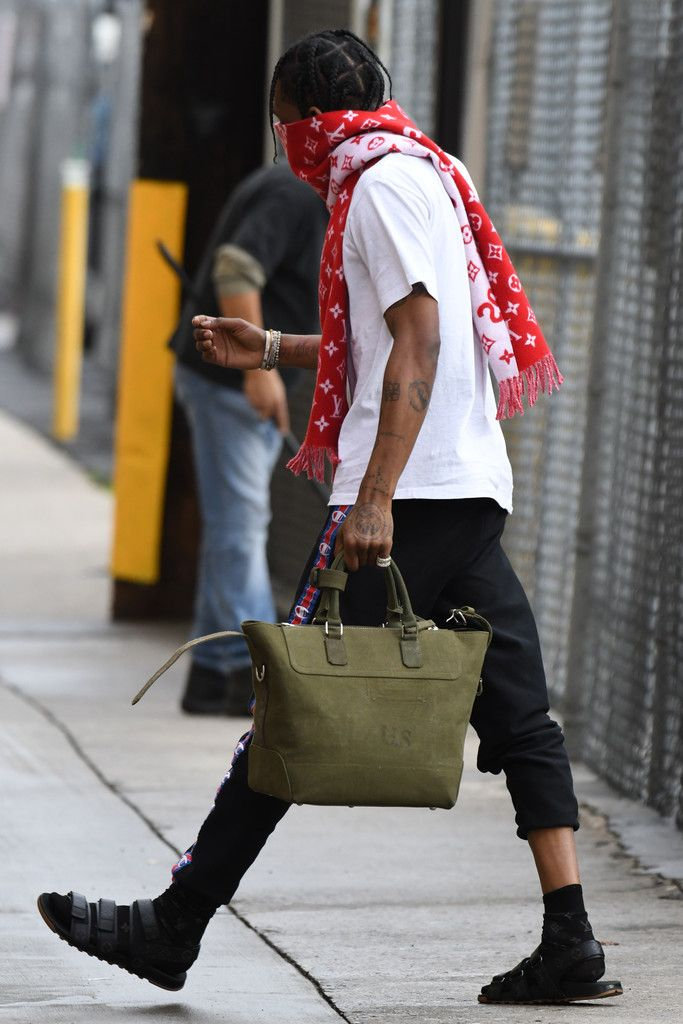 Travis Scott Rocks Louis Vuitton x Supreme Scarf, Sandals And Champion x Vetements Sweatpants