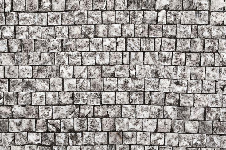 Pavimentazione in pietra di texture, di granito marciapiede ciottoli sfondo, sfondo astratto di vecchia pavimentazione cobblestone primo piano