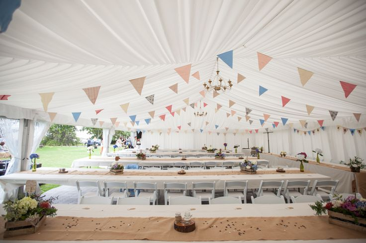 10x20m silk lined marquee, enhanced with DIY decorations from the talented Bride!