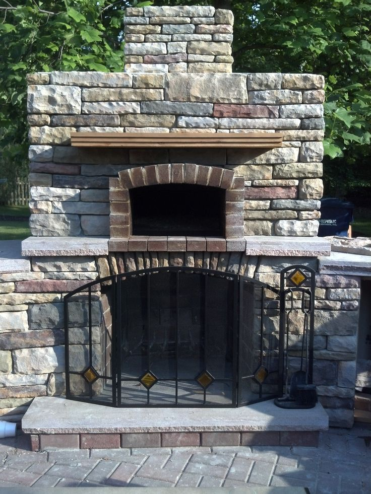 outdoor fireplace and outdoor pizza oven