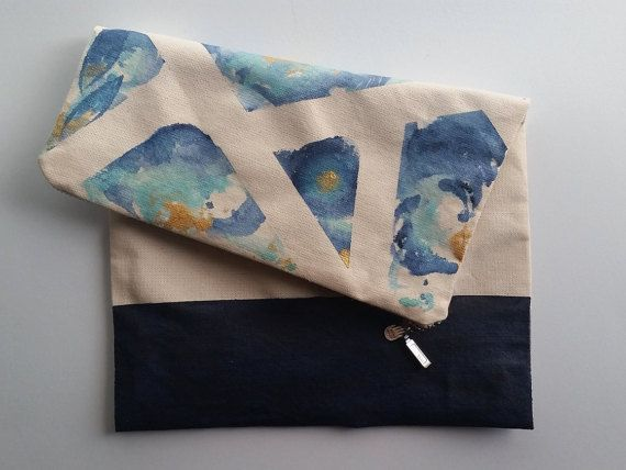 This stunning foldover clutch, has been created to represent Octobers National Down Syndrome Awareness Month. Blue and Yellow are the two colours that