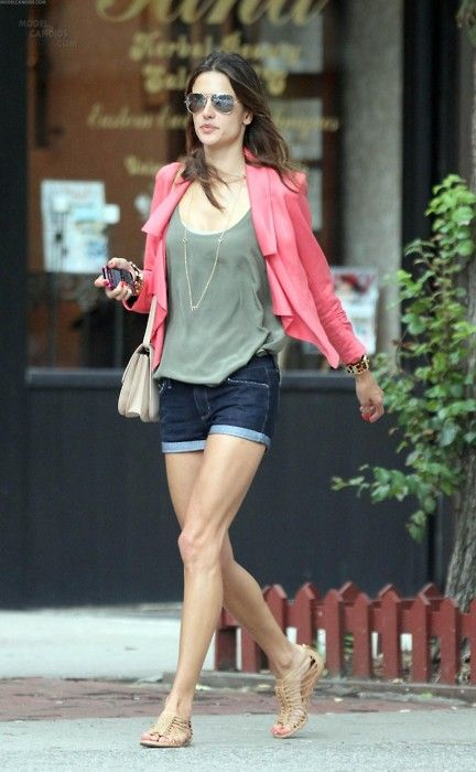 Alessandra has a long torso too but I don't notice it here. Short shorts, flats the same color as her skin. Hmmm.