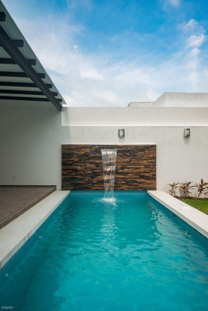 Piscinas de estilo por roka arquitectos quincho ideas for Jardines minimalistas con piscina