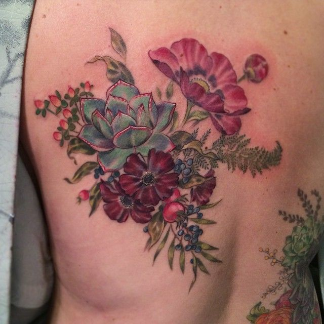 Colored flowers tattoo by Stephanie Brown