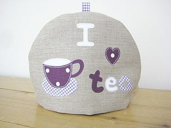 Linen/purple tea cosy