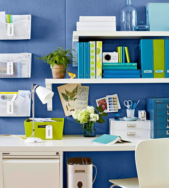 Try using floating shelves in a home office to keep the space open, yet still organized. Great use of color here too!
