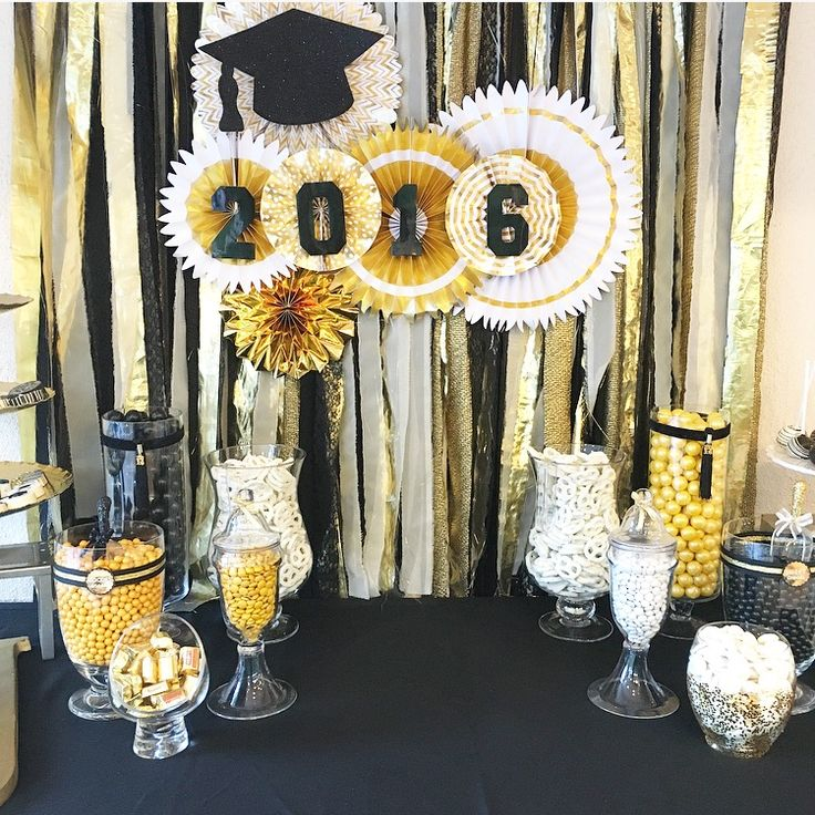Graduation Table Backdrop Using Gold Accent Paper Fans And