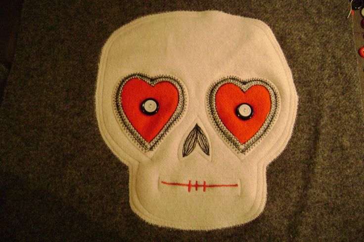 A valentine skull cushion cover.Made from old woolen blankets.