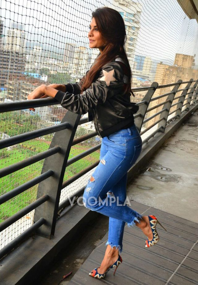 Stylish heels ripped jeans and black jacket worn by Jacqueline