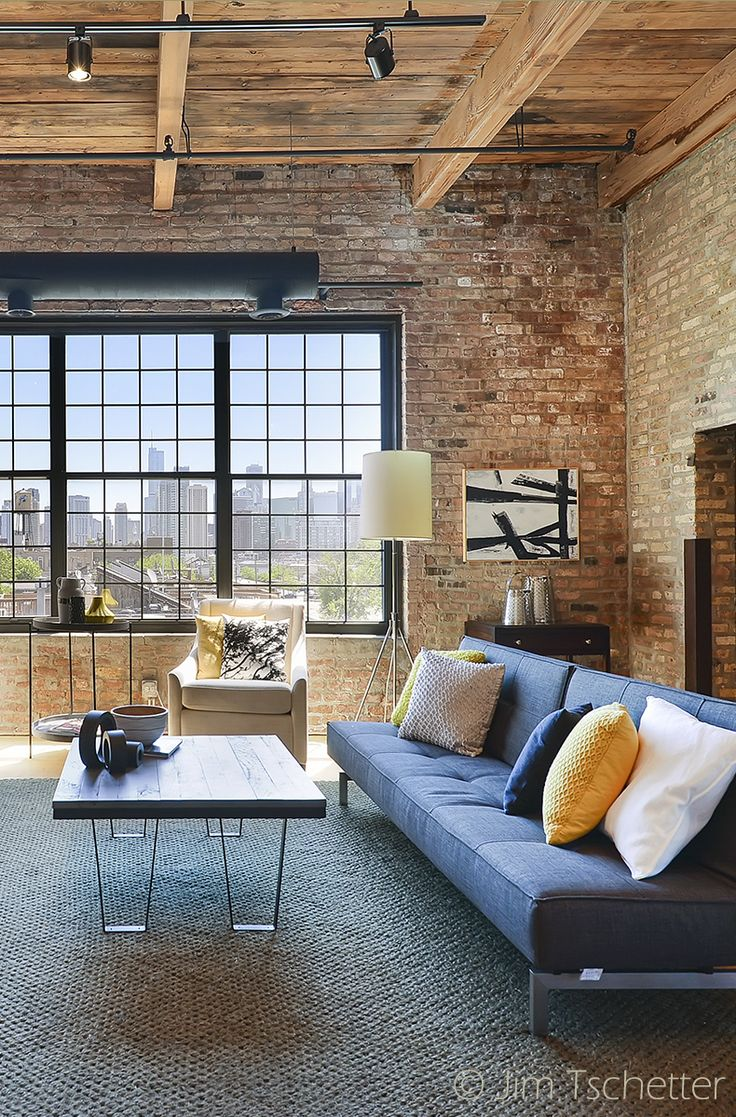 Window wall design ideas pinterest nyc home and accent walls - Brick Walls And Wooden Ceiling Add Up To That Great Illuminated Living Room Furnished With An Accent Blue Sofa