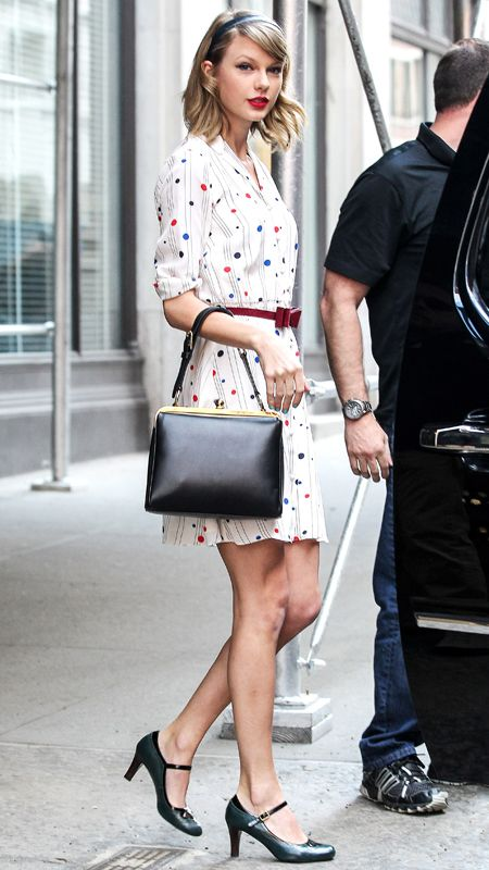 """MAY 2, 2014 The singer gave the """"To Tommy, From Zooey"""" polka-dot-striped shirtdress her personal flair with a red bow-accented belt, a top-handle Dolce  Gabbana bag, and black Mary Janes."""