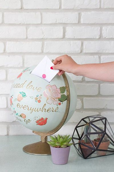 Passionate about traveling? Put your wanderlust on display with this clever wedding card box idea #crafts #travel #globe