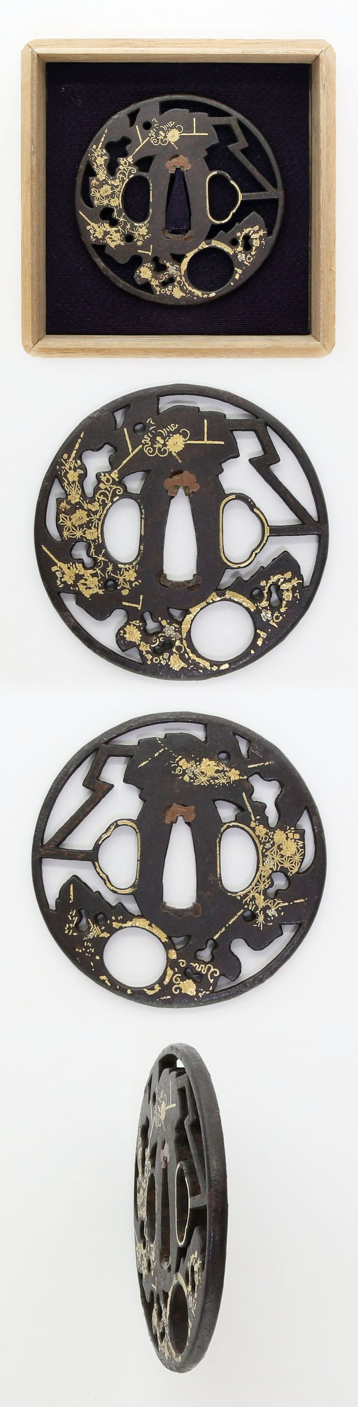 Round shape iron Tsuba with open work and flower with gold color. Edo era