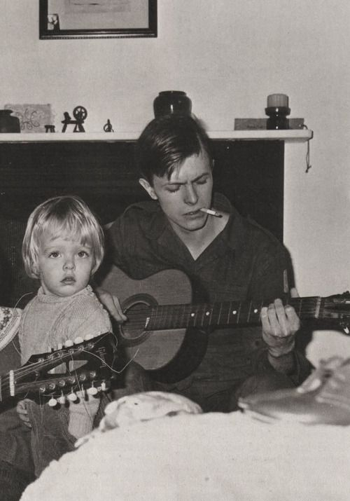 """David Bowie 1968.....with hair cut short for part in """"The Virgin Soldiers""""...with John Hutchinson's son, Christian...."""