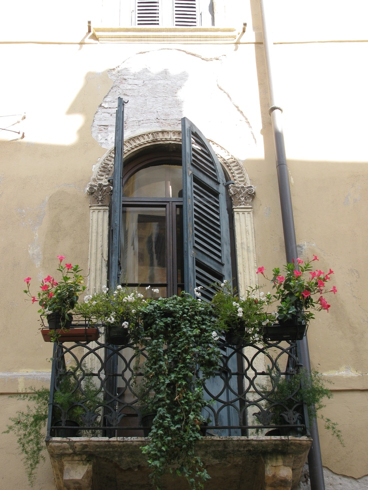 Verona italy balcony ironwork hanging gardens shutters for Balcony in italian