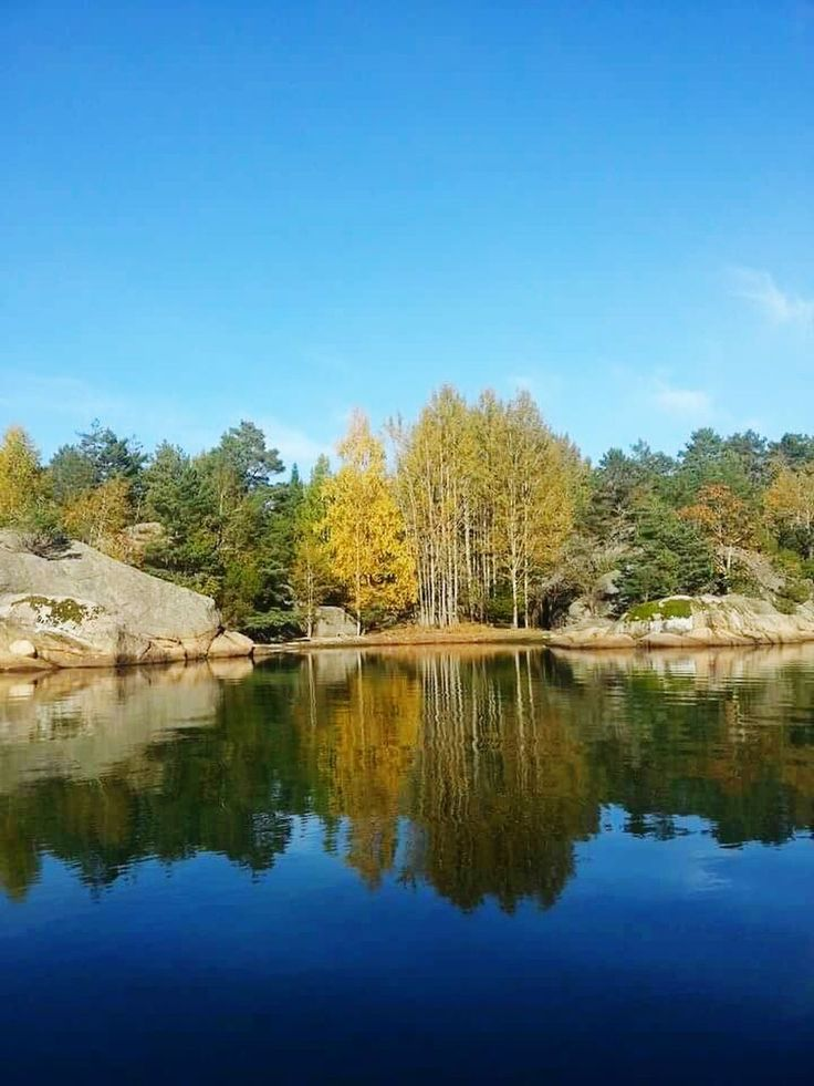 reflection, lake, tranquil scene, water, tree, tranquility, beauty in nature, nature, scenics, no people, outdoors, standing water, waterfront, day, blue, sky, mountain, clear sky