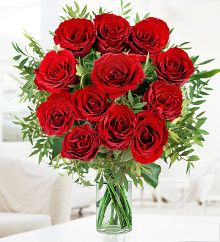 A 12 Red Rose Bouquet Delivered Direct On Valentines Day The ultimate symbol of true romance. 12 luscious red roses. This 12 red rose bouquet is lovingly arranged by talented florists and comes with a FREE box of fine Belgian Chocolates.  Click Here To View -> http://tidd.ly/f9f45530 Need Anything Else Then Visit -> https://www.facebook.com/alittlebitextra/