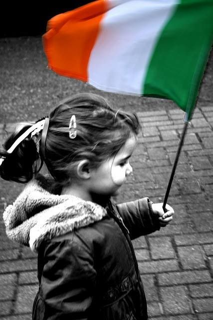 Young girl with tricolour flag.