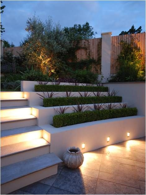 LD256s set into the planter walls on this project provide a glow of light to every other step leading up into the generous garden. The alternative levels of light between the steps that are lit and the ones that are not contrast wonderfully with the alternating appearance of the dark planting set against the light coloured stone work.