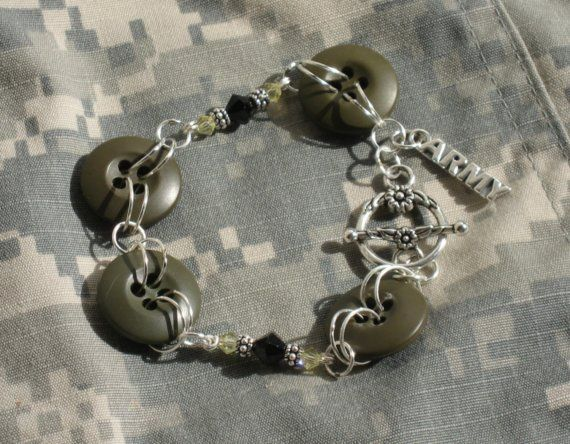 Custom listing for PROZ, clasp has been changed. This bracelet was made using buttons from the Army ACU uniform. The bracelet is accented with wire wrapped black and gold Swarovski crystals and a sterling silver Army charm. This bracelet is great for the Military wife or Military