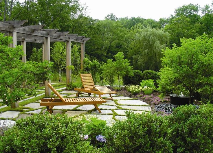 lush garden patio traditional with hydrangea wooden outdoor chaise lounges