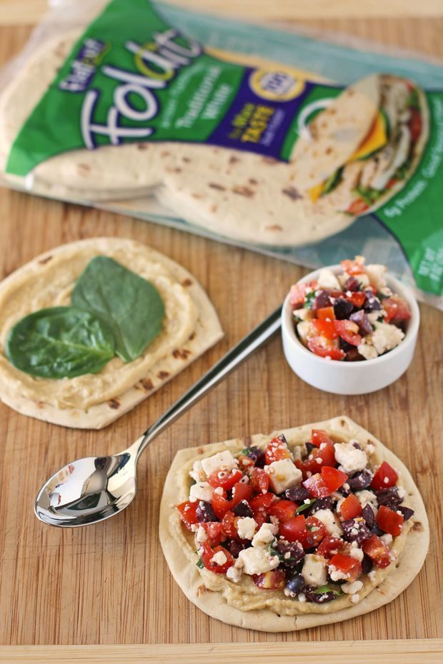 These Greek Snack Flats are the perfect healthy afternoon snack with 7 grams of protein, 4 grams of fiber and everything you need to keep you full and motivated until dinner! Just 151 calories or 4 Weight Watchers SmartPoints. www.emilybites.com