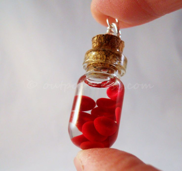 Red blood cells bottle necklace. Awesome science jewelry. Polymer clay suspended in clear gel.