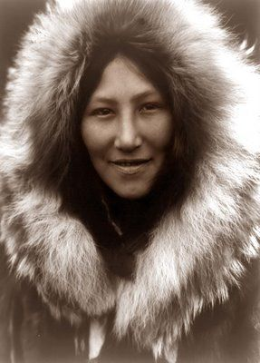 This is a picture of a Native Alaskan. The picture was taken in the early 1900's by Edward Curtis.  Absolutely enchanting : )