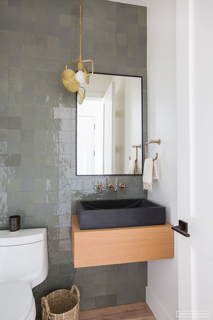 powder room, tiled feature wall, floating cabinet, black sink
