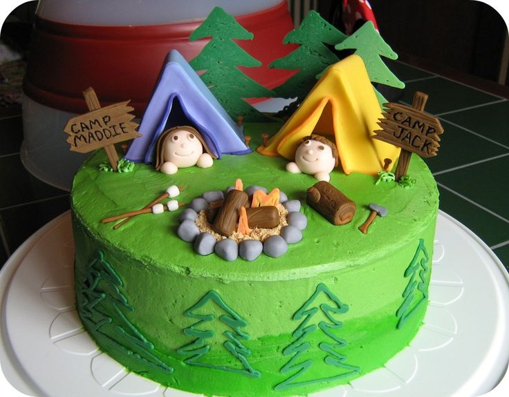 I made this camping scene cake for a double birthday party.  The kids loved that it was personalized and completely edible!  All the pieces are made with fondant and supported internally by dry spaghetti noodles.  The green iciing is buttercream and I used candy melts for the green trees and the flames in the fire pit.